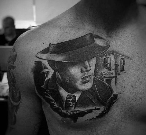 Male With Gangster Upper Chest Portrait Tattoo