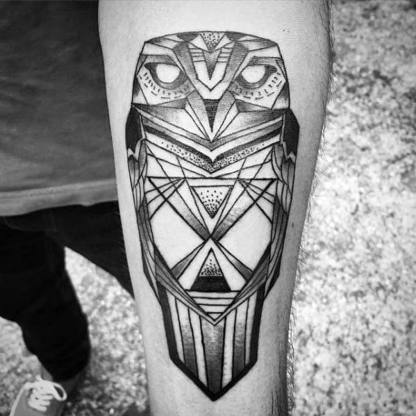 Male With Geometric Owl Tattoo Design On Inner Forearm