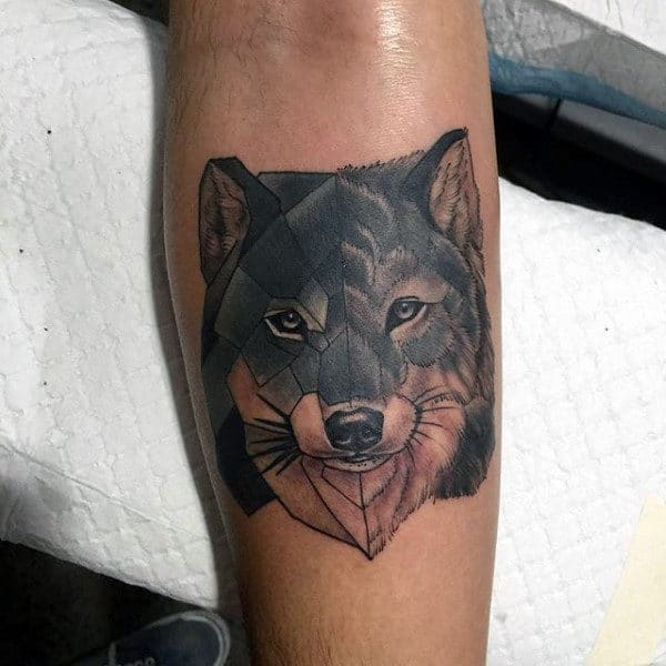 Male With Geometric Wolf Tattoo On Upper Forearm