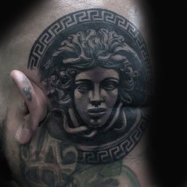 Male With Greek Medusa Head Tattoo