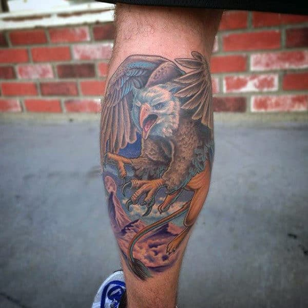 Male With Griffin Leg Calf Tattoo