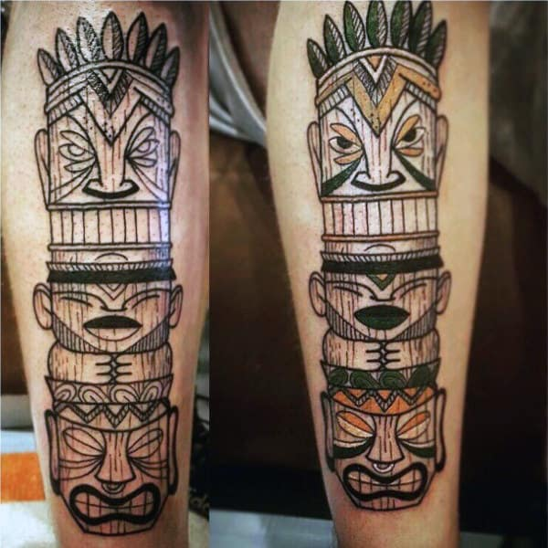 Male With Happy Face Totem Pole Calf Tattoo Line Work