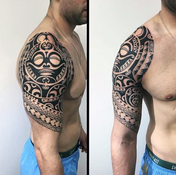 Male With Hawaiian Face Tribal Half Sleeve Tattoo Design