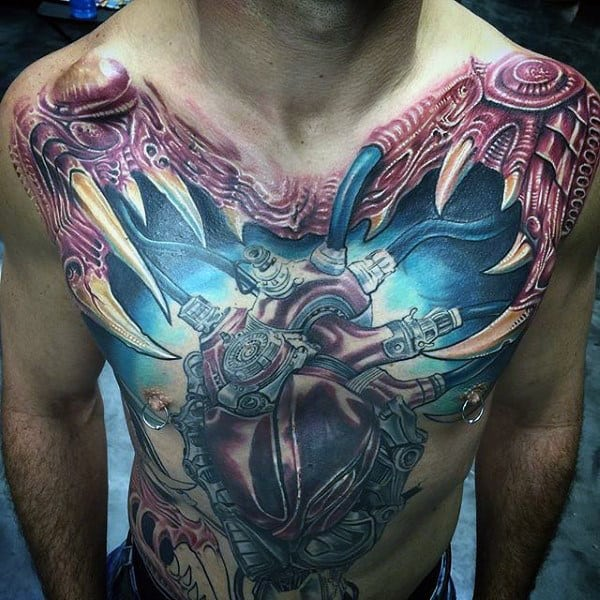 Male With Heart Tattoo Cybernatic Chest Piece With Large Teeth