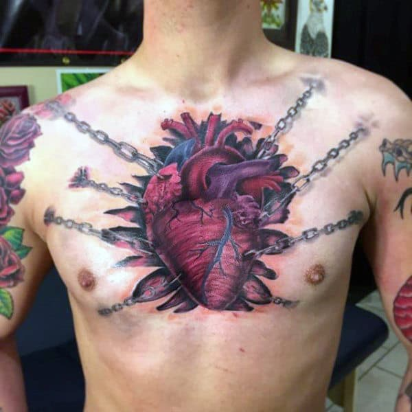 Male With Heart Tattoo Dramatically Chained To Chest