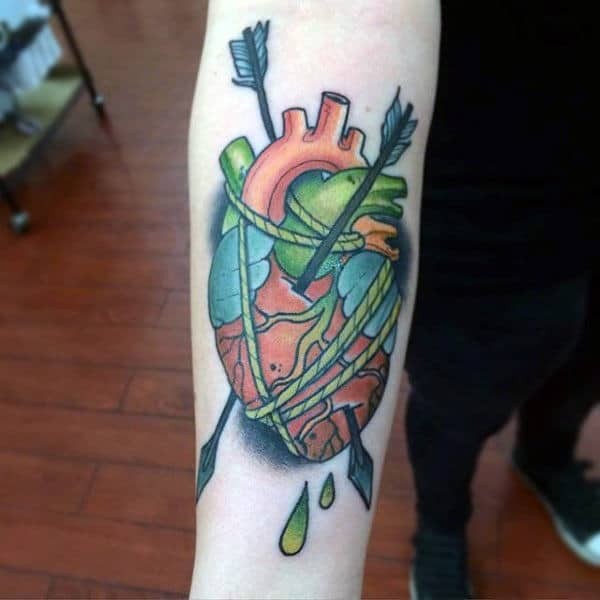 Male With Heart Tattoo In Neo Traditional Style With Bounding Rope And Arrows For Forearm
