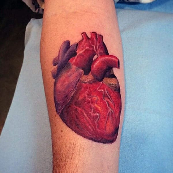 Male With Heart Tattoo In Realstic Shading Style On Forearm