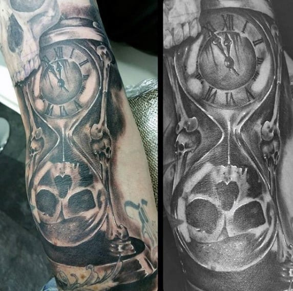 Male With Hourglass And Skull Bone Tattoo On Arm