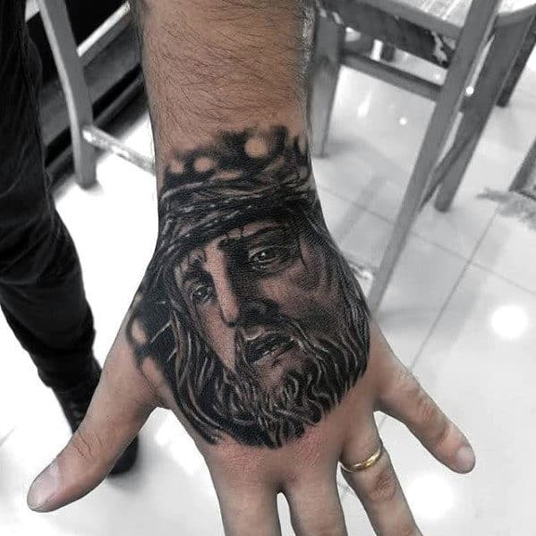 Male With Jesus Christ Religious Hand Tattoo