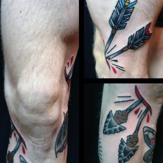 Male With Knee Cap Traditional Arrow Through Skin Tattoo