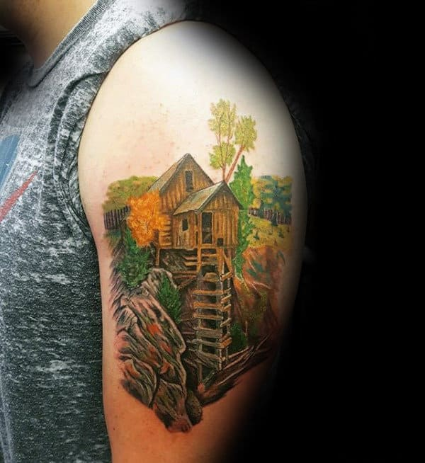 Male With Landscape Cabin Tattoo On Upper Arm