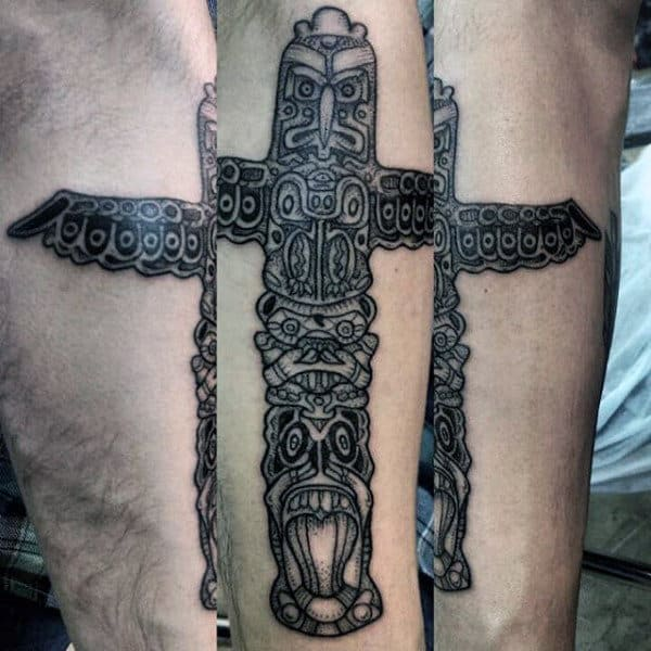 Male With Line Work Evil Totem Pole Forearm Tattoo