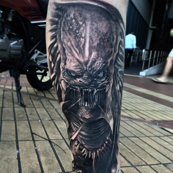 Male With Lower Leg Alien Vs Predator Tattoo