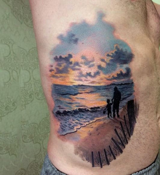Male With Man And Boy At Beach Sunset Tattoo On Side