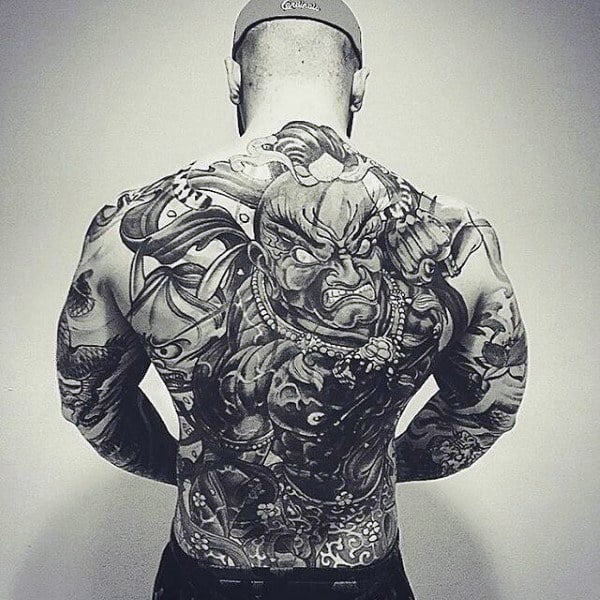 Male With Modern Full Back Tattoo In Black And Grey Ink