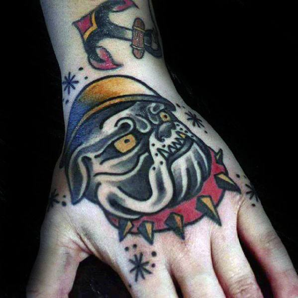 Male With Old School Hand Tattoo With Bulldog Traditional Design