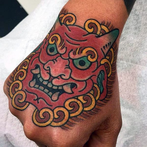 Male With Old School Japanese Demon Hand Tattoo