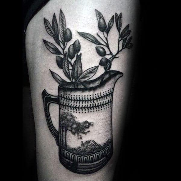 Male With Olive Branch Mug Tattoo On Thigh