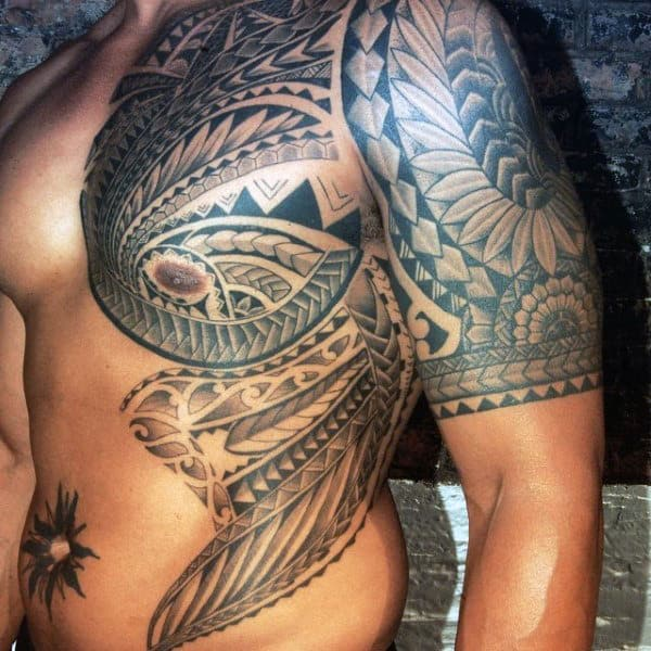 Male With Polynesian Chest And Rib Cage Side Tattoo