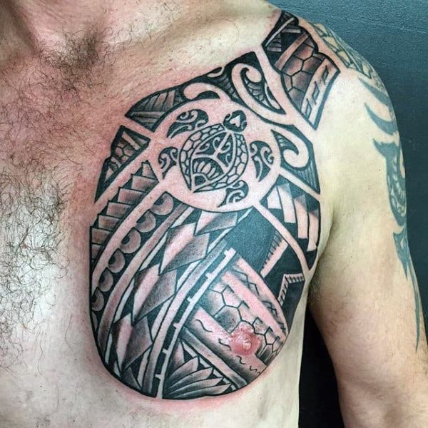 Male With Polynesian Tribal Turtle Chest Tattoo