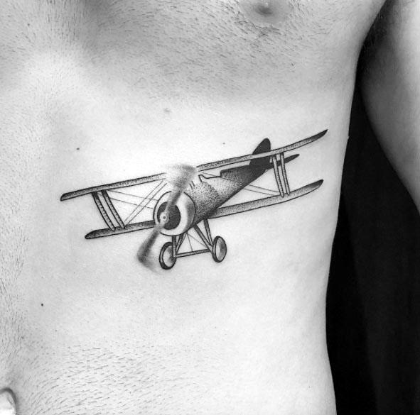 Male With Propeller Tattoos