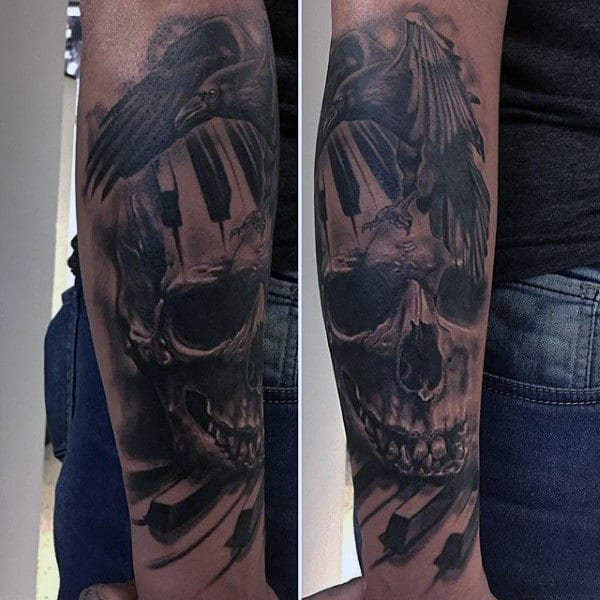 Male With Raven Skull And Piano Keys Tattoo Forearms