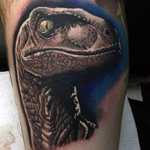 Male With Realistic 3d Velociraptor Head Tattoo On Arm