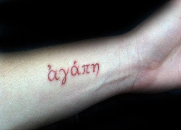 Male With Red Ink Agape Wrist Tattoo
