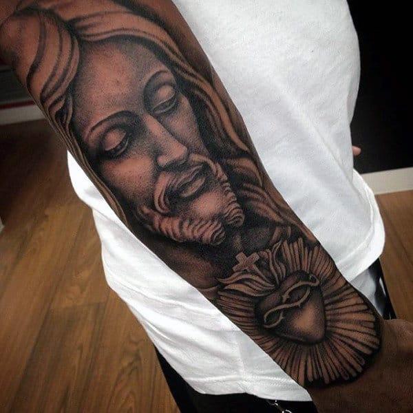 Male With Roman Catholic Sacred Heart Jesus Forearm Sleeve Tattoo Design