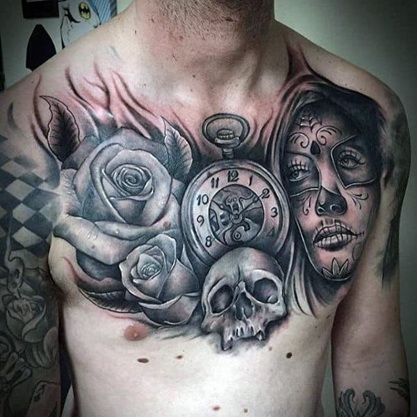Male With Rose Time Piece Skull And Day Of The Dead Lady Tattoo Chest