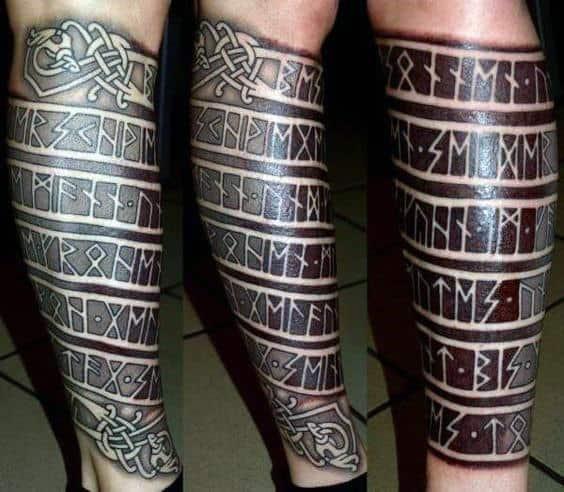 Male With Rune Leg Sleeve Tattoo