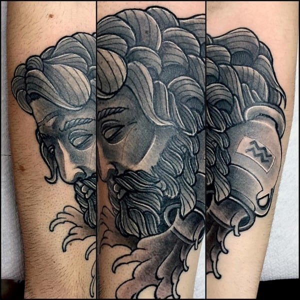 Male With Shaded Aquarius Forearm Tattoos