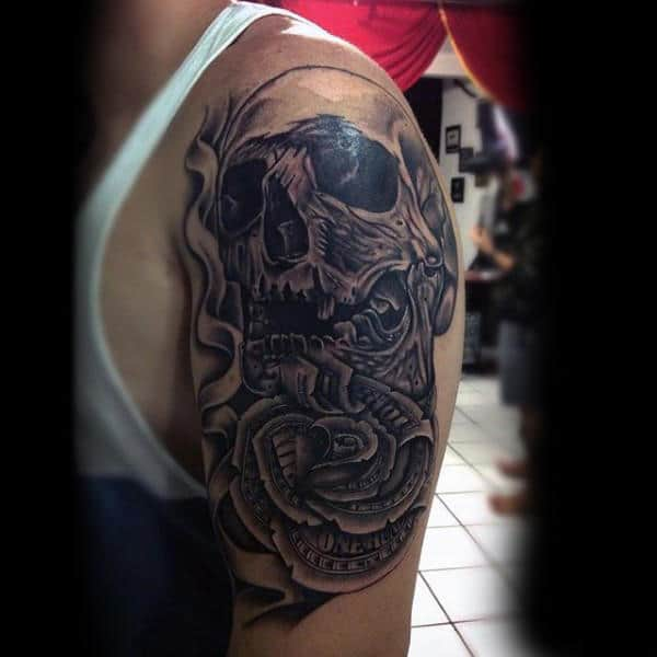 Male With Skull And Money Rose Tattoo On Upper Arm