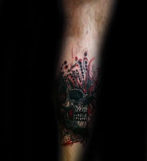 Male With Skull Trash Polka Tattoo On Leg Calf