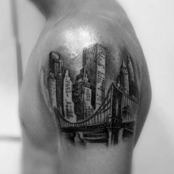 Male With Skyline Upper Arm Tattoo