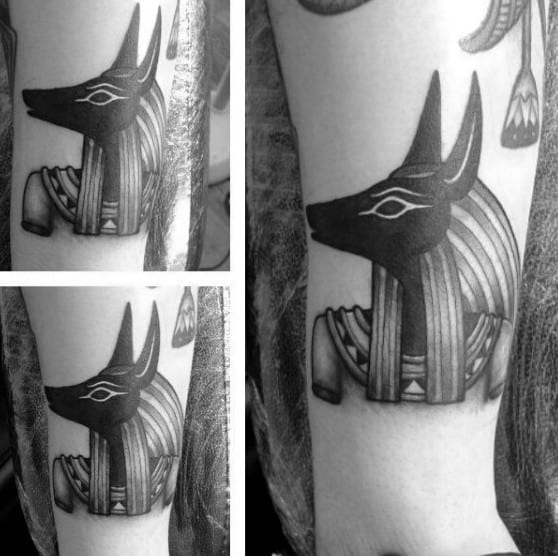 Male With Small Anubis Tattoo On Arm