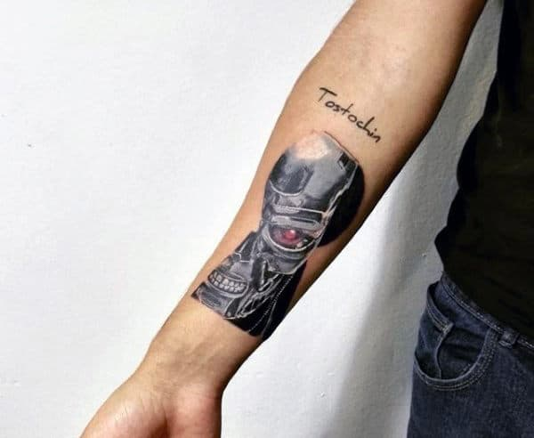 Male With Small Terminator Inner Forearm Tattoo
