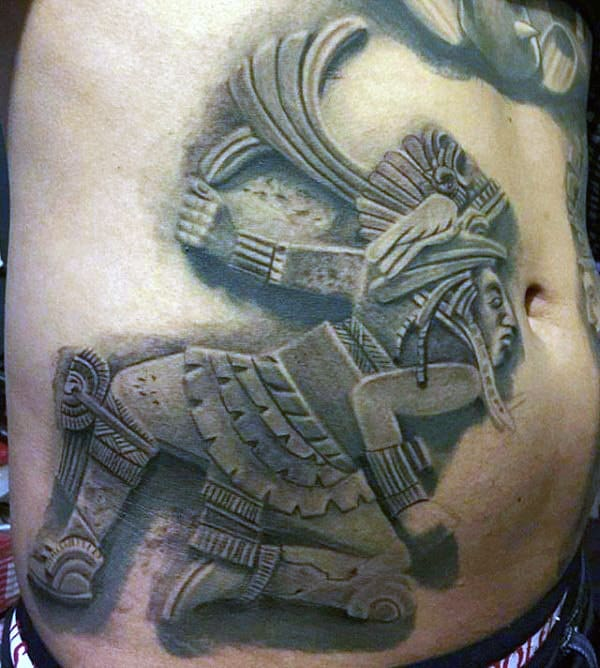 Male With Stone Mayan Stomach Tattoo
