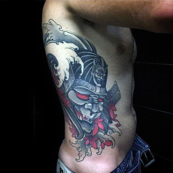 b05d22c35bfc7 Male With Sweet Tattoo Of Japnese Samuari And Water Waves On Rib Cage Side  Of Body