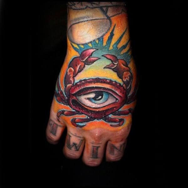 Male With Tattoo Of All Seeing Eye Red Crab On Hands