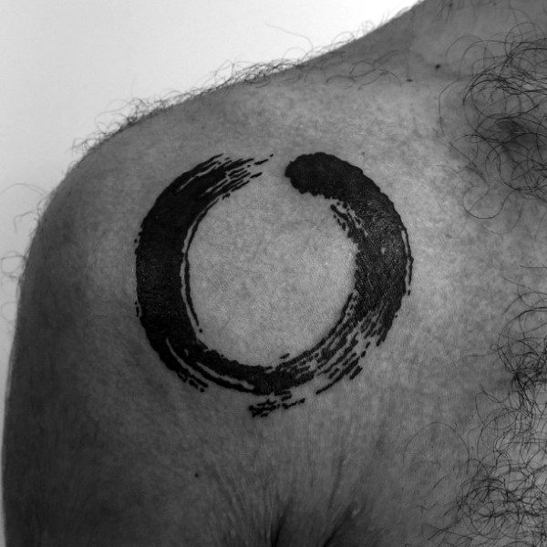 Male With Tattoo Of Enso Design On Shoulder