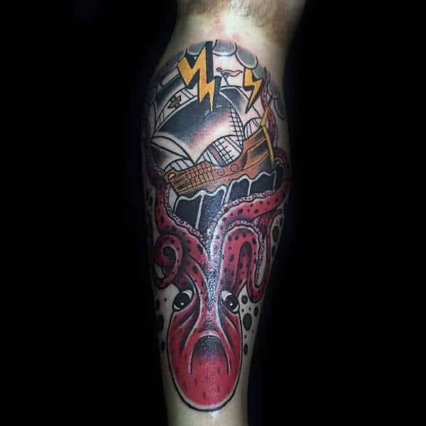 Male With Tattoo Of Japanese Style Kraken And Ship On Back Of Legs