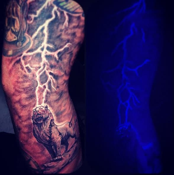 Male With Tattoo Of Lion And Thunder Black Light Ink Ideas