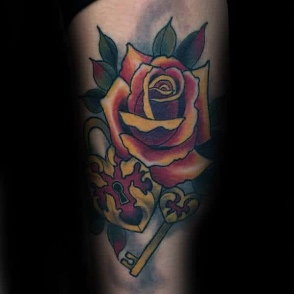 Male With Tattoo Of Lock And Rose Flower On Arm