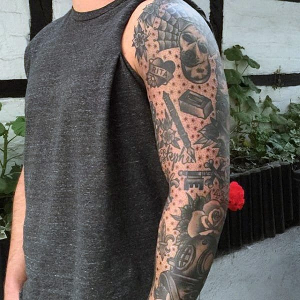 Male With Tattoo Of Traditional Sleeve Design