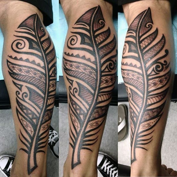Male With Traditional Feather Design Tattoo On Legs