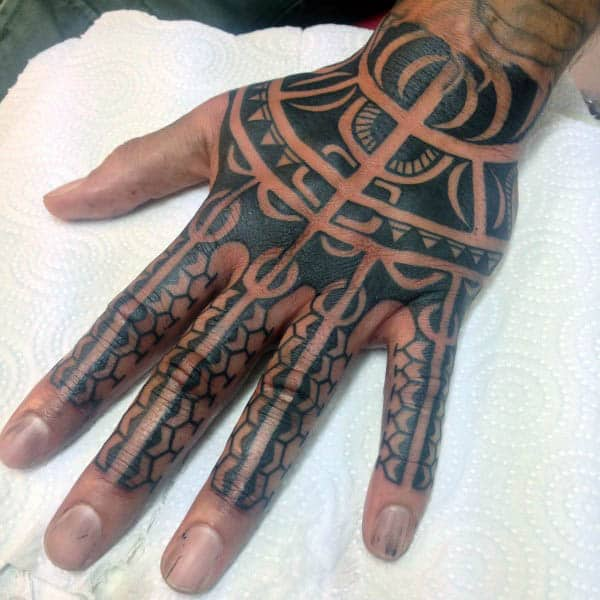 Male With Tribal Hand Tattoo