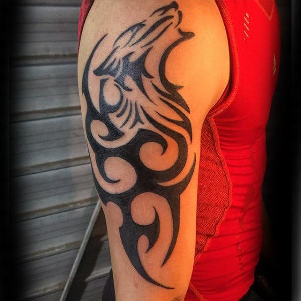 Male With Tribal Wolf Tattoo On Arm