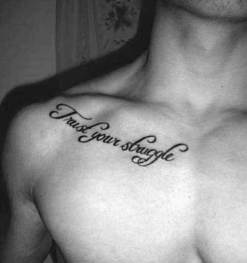 Male With Trust Your Stuggle Collar Bone Tattoo