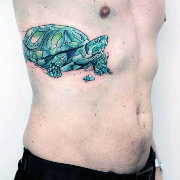 Male With Turtle Watercolor Tattoo On Rib Cage Side Of Body